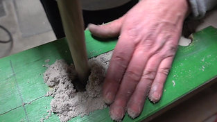 Filling a core box by hand