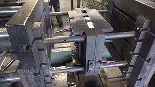 Side view of gravity die casting machine