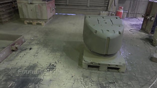 Spray coating of a larger sand core