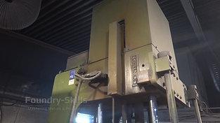 Side view of a vertical tilt casting machine
