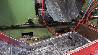 Conveyor belt beneath hot chamber high pressure die casting machine