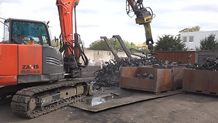 Shredding of the recycled material by using an excavator