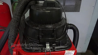 Industrial vacuum cleaner on garbage can