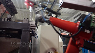 Casting part removal robot in motion