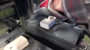 Sand core insertion of a tilt casting machine