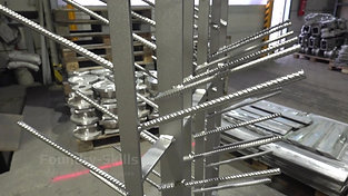 Hangers for blast cleaning chamber