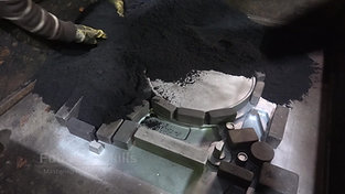 Hand moulding with furan resin bond moulding material