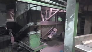 Vibrating chutes of different zones of a blast cleaning chamber