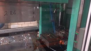 Wax injection molding machine interior view