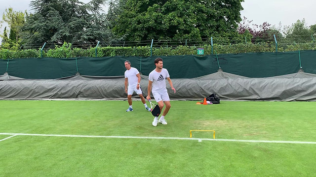 TRAINING ON THE GRASS COURT