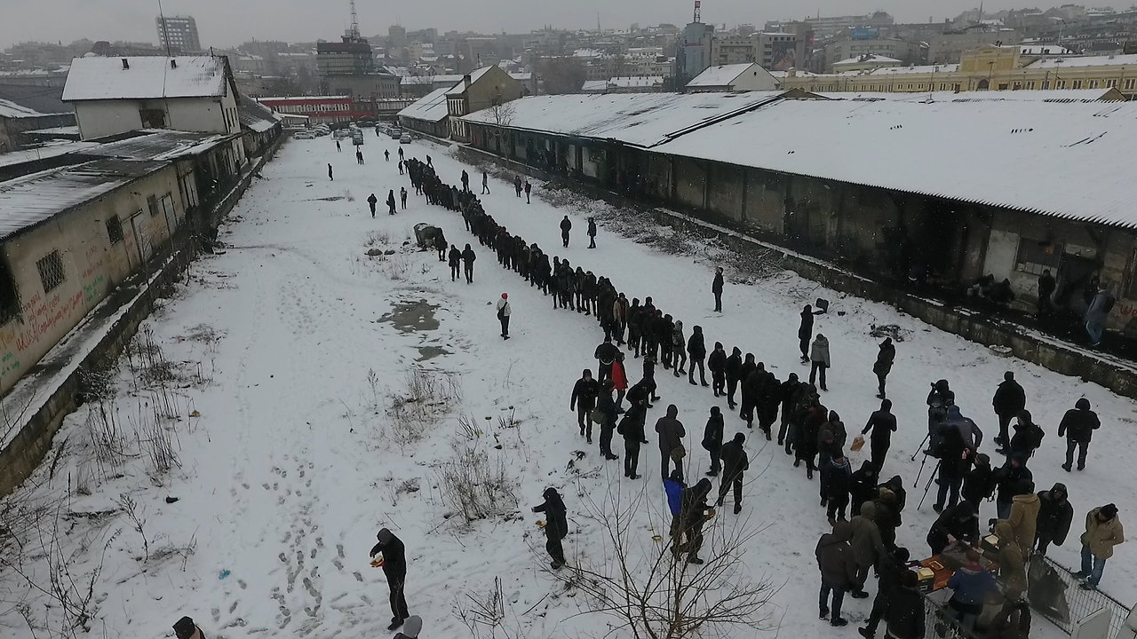 Refugees and migrants are stuck in freezing conditions behind the central train station in Belgrade, Serbia,