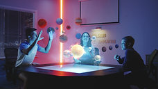children-playing-with-holographic-solar-system-EAZF6JP