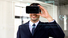 businessman-with-vr-headset-score-and-coding-8PHWZJS