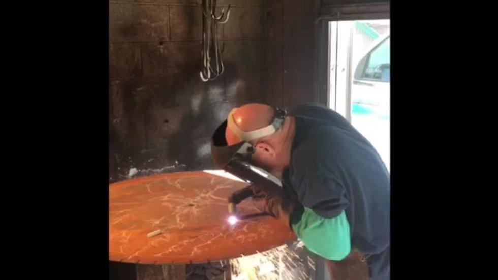 Gary cutting a saw blade