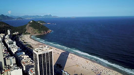 Shot reveals Sugarloaf mountain from Leme beach
