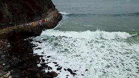 waves hit the rocks