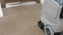 Office carpet cleaning in front of lift doors.