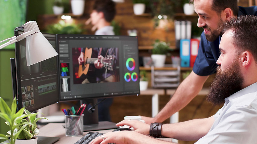 professional-colorist-and-video-editor-working-on-NT29AKQ