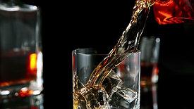 Whiskey pouring, camera follows liquid