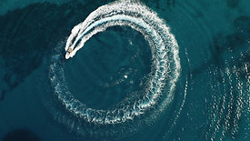 Top view of speed boat making circle