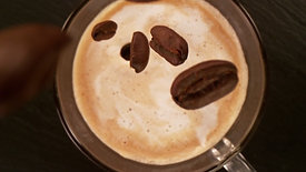 Camera motion, falling coffee beans into coffee cup