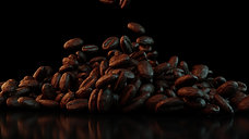 Coffee beans falling on the table on a dark background 2