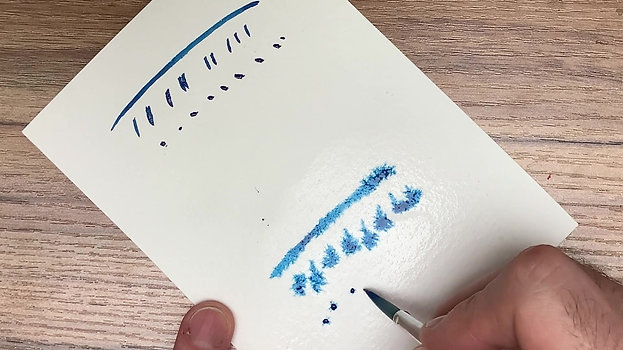 putting paint onto paper