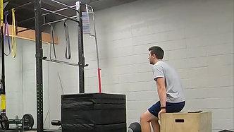 Box squats to seated box jumps