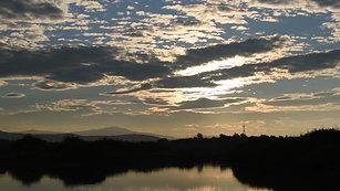Sunrise through mountains