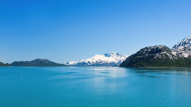 Blue water and snow covered mountains