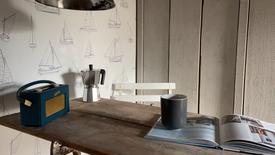 Sailing boats wallpaper against grey woodwork