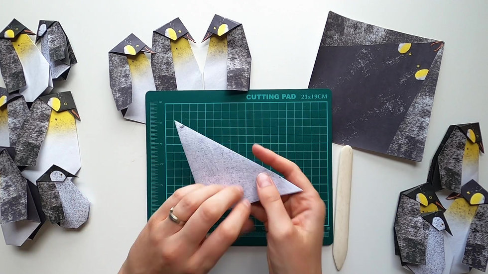 Making an origami huddle of penguins
