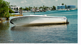 Why are Boats being abandoned in Miami?