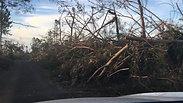 Driving through cyclone damage to AoG in Lekutu